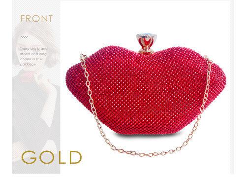 Красная женская сумочка с красными губами и кристаллами